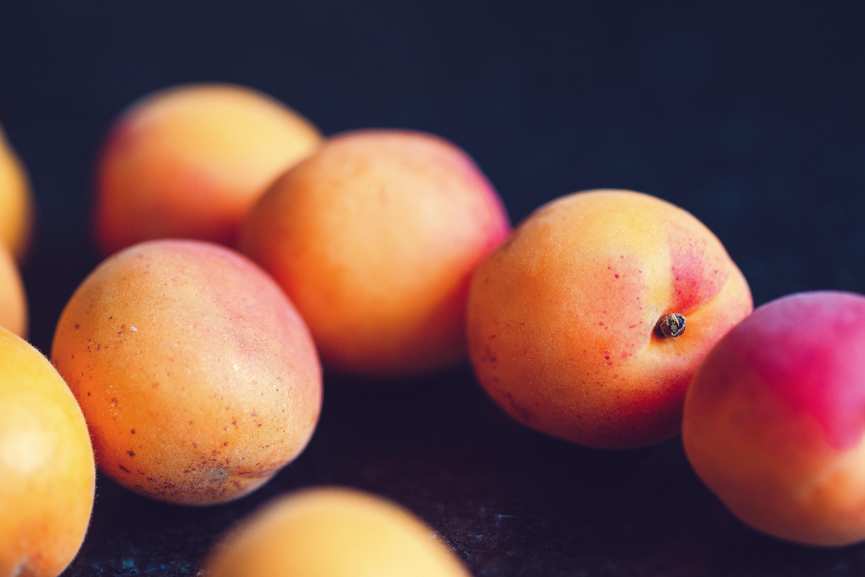 Peaches against dark backgrounds