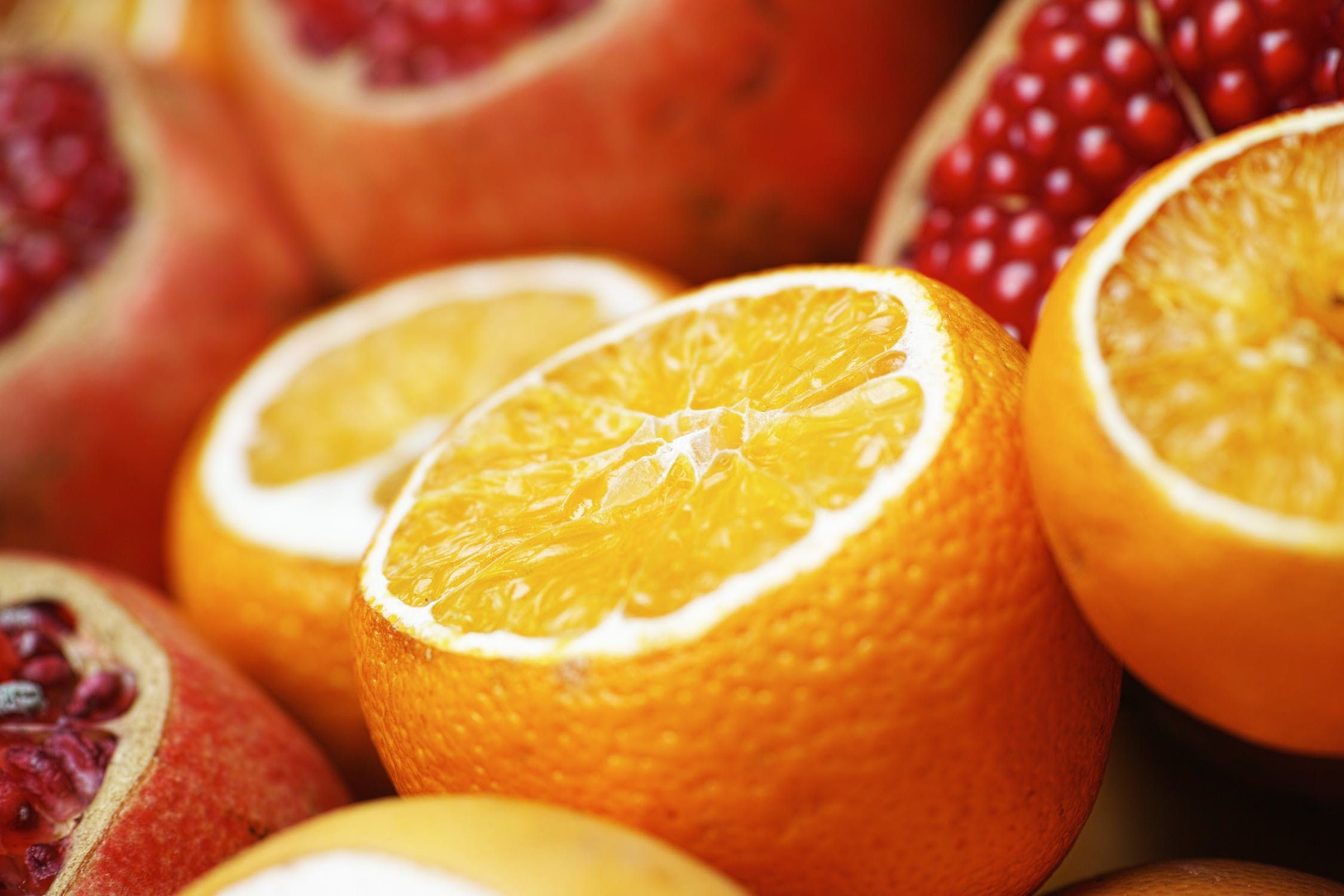 Close-up of oranges and pomegranate