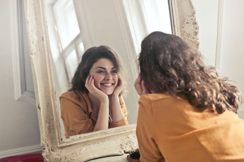 woman smiling in mirror.jpg